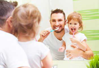 Happy family brushing teeth